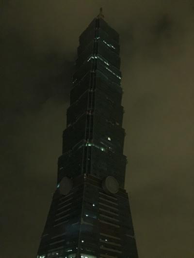 Taipei 101 at night in light fog